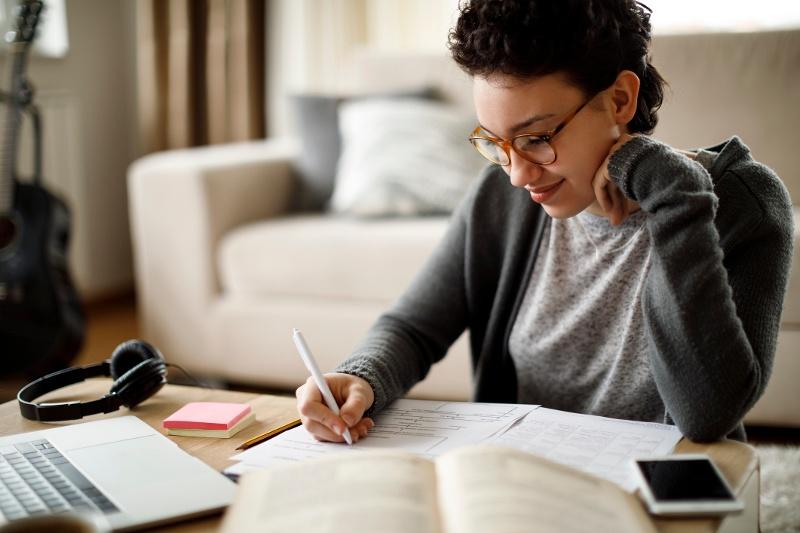 graduate student engaging in graduate school online